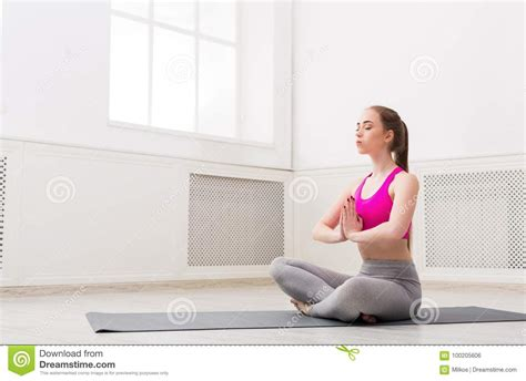 yoga relax tutorial woman training yoga in lotus pose copy space stock photo