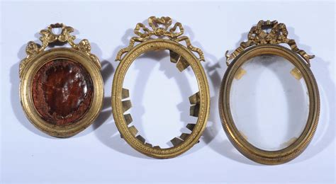 cornici ovali tre cornici ovali da miniature in bronzo dorato xix