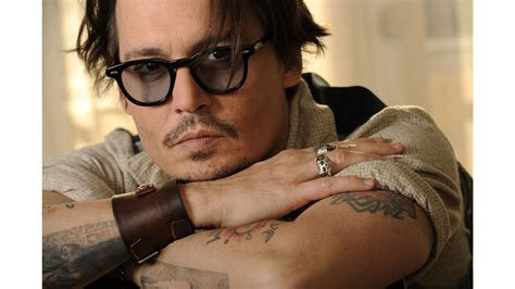 johnny tattoo hd johnny depp has sued his former business managers for 25