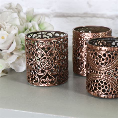 set of 3 copper and gold light up holiday presents set of three copper tea light votive candle holder round