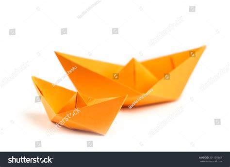 Orange Origami Paper - orange origami paper boats isolated on white stock photo
