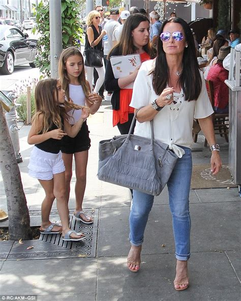 what does kyle richards do to make her hair look thicker kyle richards of rhobh keeps outfit simple for a family
