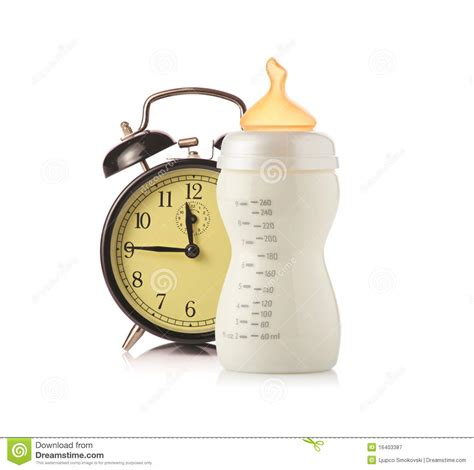 alarm clock  baby feeding bottle  milk royalty