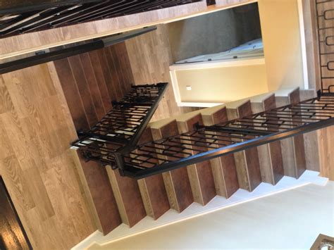 Glass Backsplashes For Kitchens gulf tile s porcelain wood tile stairs amp flooring project