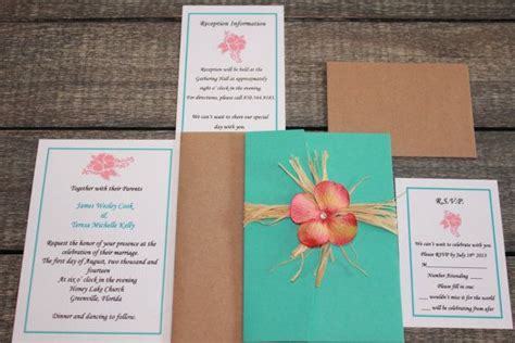 rustic and themed island getaway tropical turquoise and coral wedding invitation set