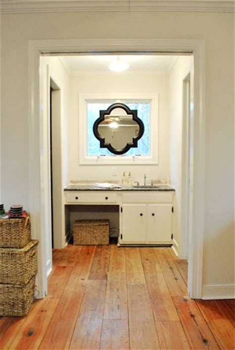 hanging a sink mirror in front a window house love