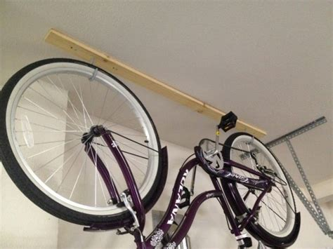 Hooks To Hang Bicycles In Garage by How To Store Surfboards Paddle Boards And Cruisers