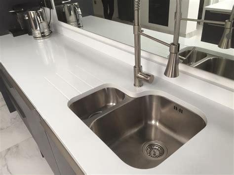 white stainless steel sink kitchen worktops granite line