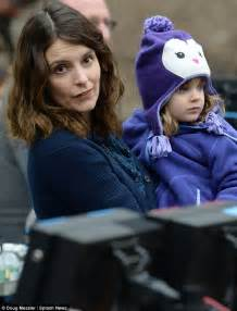 Tina Fey tends to her adorable daughter Penelope as she oversees filming of new sitcom Tooken