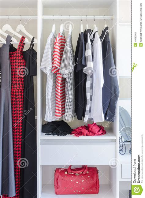 How To Store Shirts In Closet by White Closet With Shirt And Dress Hanging Stock Photo