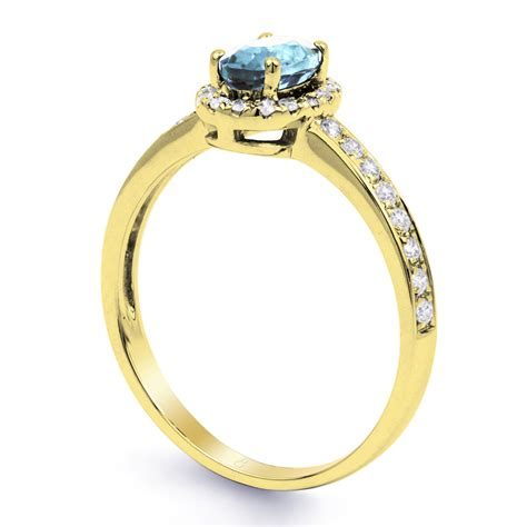 new 18 carat yellow gold aquamarine halo