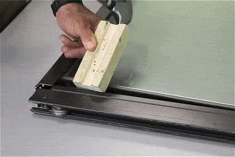 How To Replace Patio Door Rollers Diy Guide How To Replace A Sliding Patio Glass Door Roller Removing The Bottom Part Of The