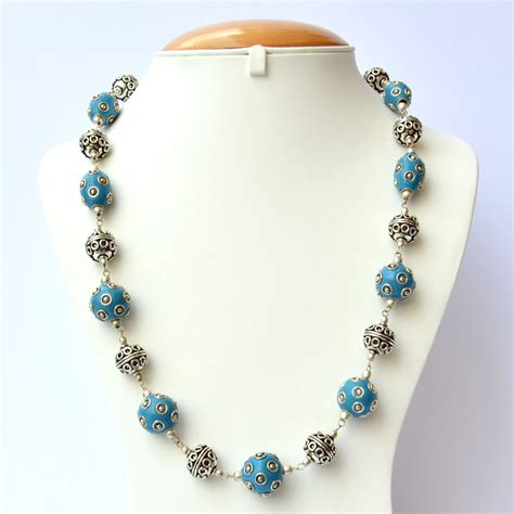 Handmade Necklaces - blue handmade necklace studded with silver plated rings
