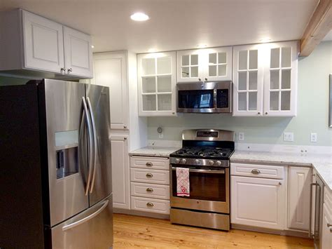 painting light maple cabinets white sound finish cabinet painting refinishing seattle