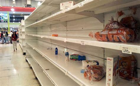 imagenes de venezuela escases mindefensa ordena entregar armas largas a la milicia para