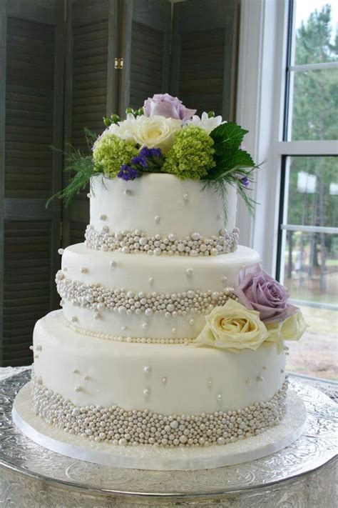 flowers for wedding cakes real 3 tiered white wedding cake with silver fondant pearls and