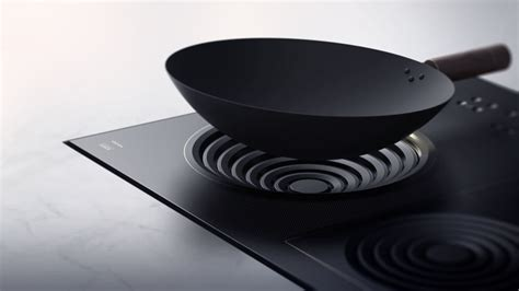 induction stove features hi portable induction cooktop changes shape to fit woks
