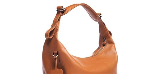 News Bags Baubles And Bottles Wine And Bags Extravaganza by Handbag Holds Essentials Id And Bottle Of Wine