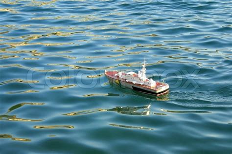 Lake Front Home Plans Toy Ship Floating On The Water Stock Photo Colourbox