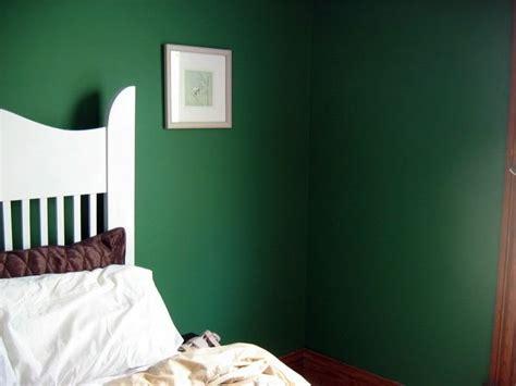 lovely dark green walls   fashioned heavy dark wood