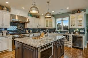 Kitchen With Antique White Cabinets, Black Subway Tile, Wood Island