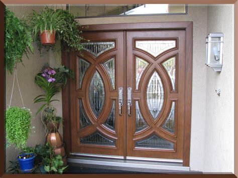 Custom Size Exterior Doors Custom Size Exterior Fiberglass Doors With Oak Wooden Door And Hanging Potted Herb Plants