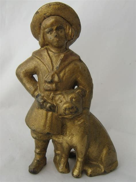 buster brown s early 1900s buster brown tige cast iron still bank from