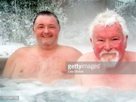guys in bathtubs portrait of men in hot tub stock photo getty images