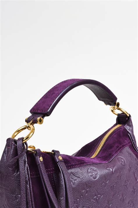 louis vuitton purple monogram empreinte leather suede trim