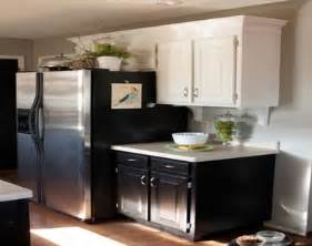 kitchen white top cabinets black bottom cabinets pictures