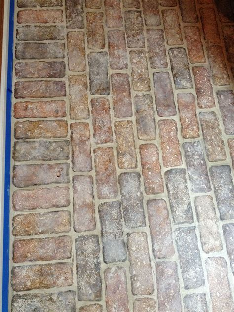 faux bricks painted   concrete floor  ripped