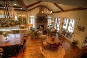 Country great room with vaulted ceiling stone fireplace hand woven