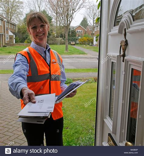 mail wimen at royal mail postwoman delivering mail to a customer stock