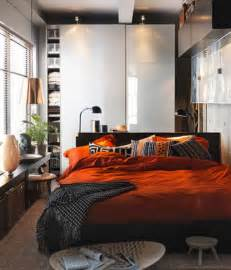 Photo of small bedroom design and decorating idea orange and brown