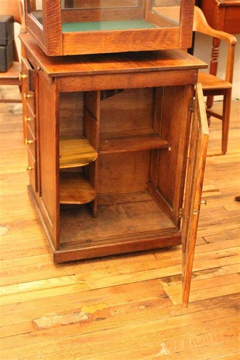 Antique Display Cabinet With Drawers Antique Oak Revolving Display Case With Locking Drawers At