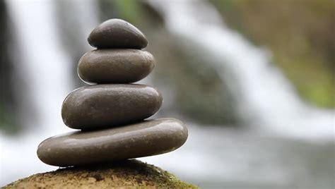 stacked zen stones and waterfall stock footage video