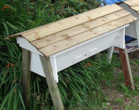 horizontal top bar hive photos using bee keeping in education