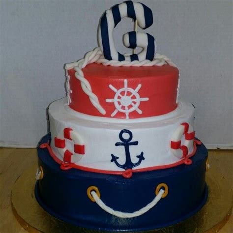 boat steering wheel diaper cake nautical themed 3 tier cake with buttercream anchors and