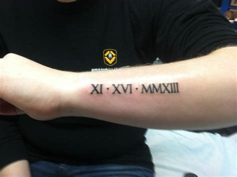roman numeral birthday tattoo numerals of ian s birthday on my arm my