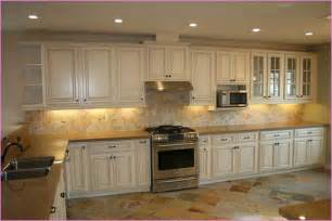 wonderful Do It Yourself Painting Kitchen Cabinets #6: white-distressed-kitchen-cabinets.jpg