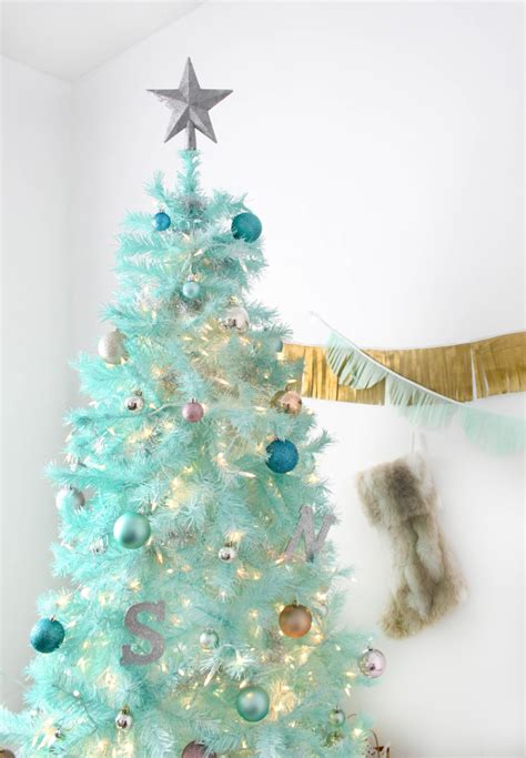 spray painted christmas trees diy mint green tree spray painted tree a joyful riot