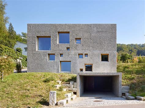 The Home by Modern Concrete House Puntured With Square Windows Digsdigs