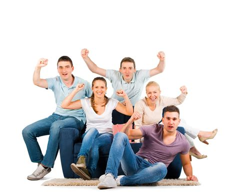 the sofa people young people sitting on a sofa cheering stock photo