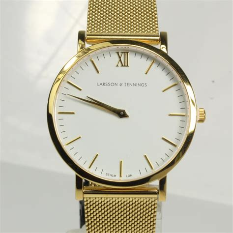 mens gold colored larsson and property room