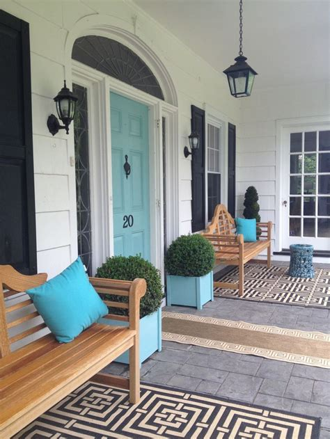 front porch rugs front porch design with chippendale benches turquoise front door and planters patterned rug