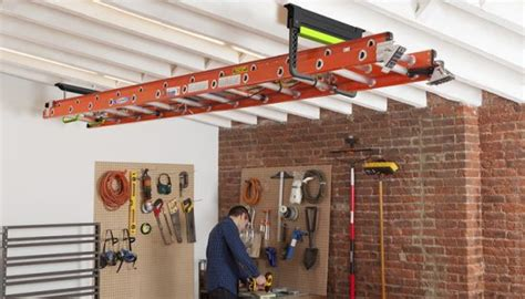 ceiling ladder storage clutch functions like a click top pen makes ladder