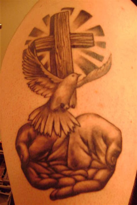 trinity cross tattoo cross dove