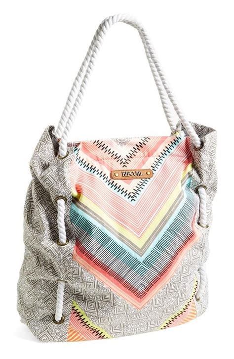 weekend favorite rip curl canvas tote with mint and coral accents the rope handle adds a