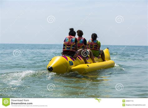 Banana Boat Blue banana boat in blue sea and clear sky editorial stock image