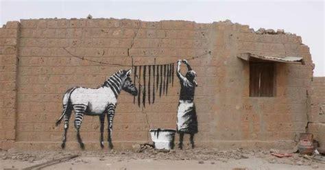 banksy african street  graffiti art